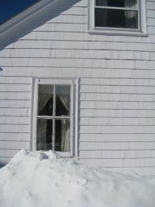 side of house in snow